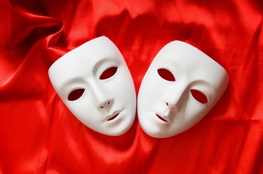 white masks on a red sheet