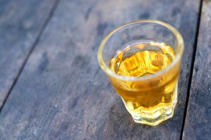 3_small-shot-glass-of-whiskey-on-a-table
